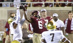 Notre Dame cornerback Clarence Lewis (6) intercepts a pass in front of Florida State wide receiver Keyshawn Helton (6) in the third quarter of an NCAA college football game Sunday, Sept. 5, 2021, in Tallahassee, Fla. (AP Photo/Phil Sears)