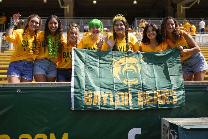 Baylor fans pose for a photo prior to an NCAA college football game against Iowa State, Saturday, Sept. 25, 2021, in Waco, Texas. (AP Photo/Jim Cowsert)