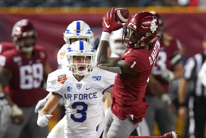 Washington State wide receiver Davontavean Martin makes a catch in front of Air Force defensive back Milton Bugg III (3) during the first half of the Cheez-It Bowl NCAA college football game Friday, Dec. 27, 2019, in Phoenix. (AP Photo/Rick Scuteri)