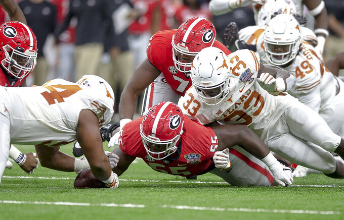 Texas defensive lineman Gerald Wilbon (94) recovers a fumble by Georgia running back D'Andre Swift during the first half of the Sugar Bowl NCAA college football game Tuesday, Jan. 1, 2019, in New Orleans. (Nick Wagner/Austin American-Statesman via AP)