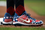 Chicago Cubs' Anthony Rizzo wears shoes with a Stars and Stripes theme as he stands on third base during the first inning of the team's baseball game against the Pittsburgh Pirates in Pittsburgh, Thursday, July 4, 2019. (AP Photo/Gene J. Puskar)
