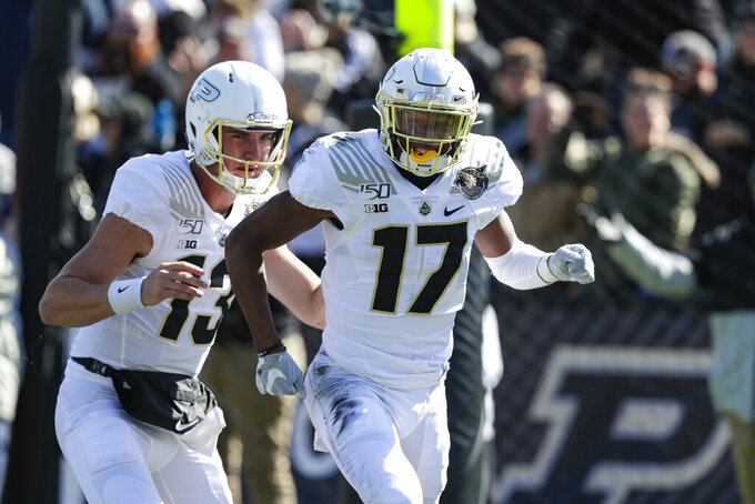 Purdue wide receiver Milton Wright (17) celebrates a touchdown with quarterback Jack Plummer (13) during the first half of an NCAA college football game against Maryland in West Lafayette, Ind., Saturday, Oct. 12, 2019. (AP Photo/Michael Conroy)