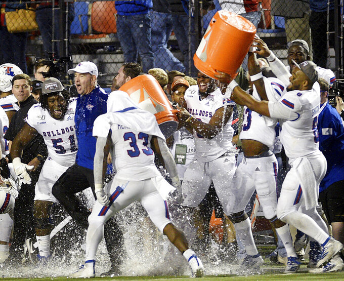 Louisiana Tech head coach Skip Holtz (white cap) is doused by his players after they won the NCAA college football Independence Bowl against Miami, Thursday, Dec. 26, 2019, at Independence Stadium in Shreveport, La. (Henriette Wildsmith/The Shreveport Times via AP)