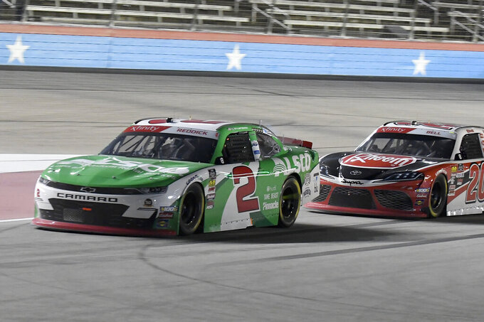 Tyler Reddick (2) leads Christopher Bell, right, onto pit road during a NASCAR Xfinity auto race at Texas Motor Speedway in Fort Worth, Texas, Saturday, Nov. 2, 2019. (AP Photo/Randy Holt)