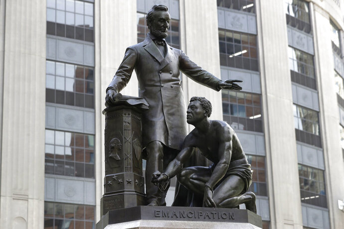 A statue that depicts a freed slave kneeling at Abraham Lincoln's feet rests on a pedestal, Thursday, June 25, 2020, in Boston. The statue in Boston is a copy of the Emancipation Memorial, also known as the Emancipation Group and the Freedman's Memorial, that was erected in Lincoln Park, in Washington, D.C., in 1876. Three years later, the copy was installed in Boston. Calls are mounting for the removal of both statues. (AP Photo/Steven Senne)