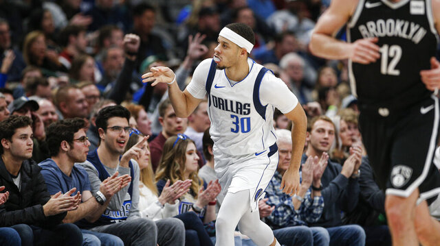 Dallas Mavericks guard Seth Curry (30) celebrates a 3-point shot during the second half of the team's NBA basketball game against the Brooklyn Nets on Thursday, Jan. 2, 2020, in Dallas. (AP Photo/Brandon Wade)