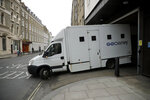A prison van carrying unknown occupants leaves Westminster Magistrates Court in London, shortly after fugitive Indian diamond tycoon Nirav Modi was denied bail in a hearing, Wednesday, March 20, 2019. Modi, who is wanted over his alleged involvement in a $2 billion banking fraud, has been arrested in London at the request of Indian authorities. (AP Photo/Matt Dunham)