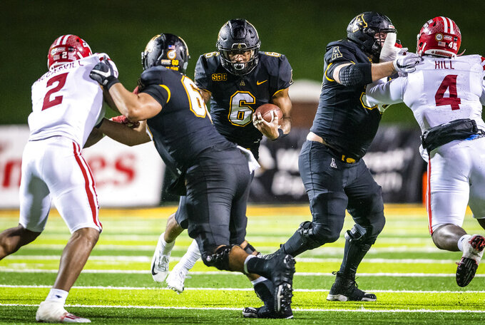 Appalachian State running back Camerun Peoples (6) runs the ball against Louisiana during an NCAA college football game Friday, Dec. 4, 2020, in Boone, N.C. (Andrew Dye/The Winston-Salem Journal via AP)
