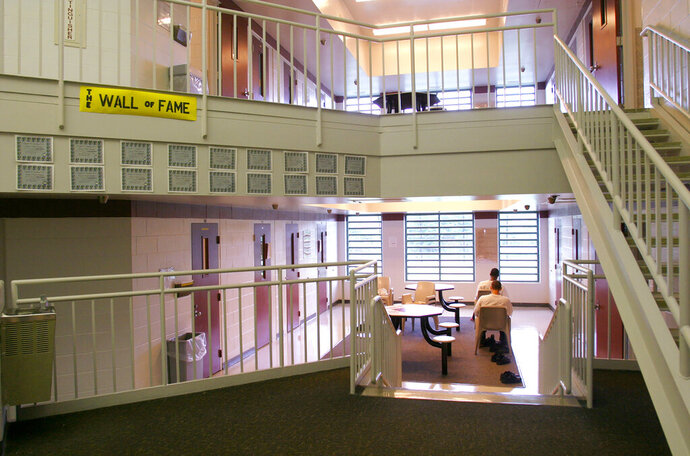 FILE - This May 18, 2004 file photo shows Inmates sitting in one of the cottages at the Circleville Juvenile Correctional Facility in Circleville, Ohio. A new federal report has found the number of kids who say they've been sexually victimized while in juvenile detention centers is dropping across the U.S. compared to years past. But remarkably high rates of sexual victimization persist in 12 facilities stretching from Oregon to Florida, including Circleville, according to the U.S. Bureau of Justice Statistics special report released Wednesday, Dec. 11, 2019. (Tim Revell/The Columbus Dispatch via AP, File)
