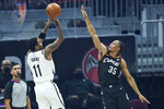 Brooklyn Nets' Kyrie Irving (11) shoots over Cleveland Cavaliers' Isaac Okoro (35) during the first half of an NBA basketball game, Wednesday, Jan. 20, 2021, in Cleveland. (AP Photo/Tony Dejak)