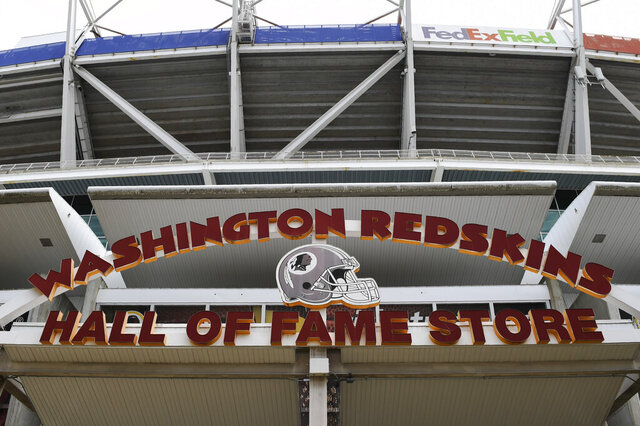 "Signs for the Washington Redskins are displayed outside FedEx Field in Landover, Md., Monday, July 13, 2020.  The Washington NFL franchise announced Monday that it will drop the ""Redskins"" name and Indian head logo immediately, bowing to decades of criticism that they are offensive to Native Americans. (AP Photo/Susan Walsh)"