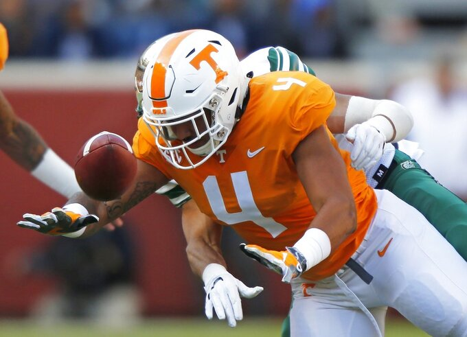 Tennessee tight end Dominick Wood-Anderson (4) can't control the ball as he's defended by Charlotte linebacker Juwan Foggie (21) in the first half of an NCAA college football game Saturday, Nov. 3, 2018, in Knoxville, Tenn. (AP Photo/Wade Payne)