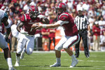South Carolina quarterback Jake Bentley (19) makes a handoff to South Carolina wide receiver Deebo Samuel (1) during the first half of an NCAA college football game Saturday, Sept. 1, 2018, in Columbia, S.C. South Carolina defeated Coastal Carolina 49-15. (AP Photo/Sean Rayford)