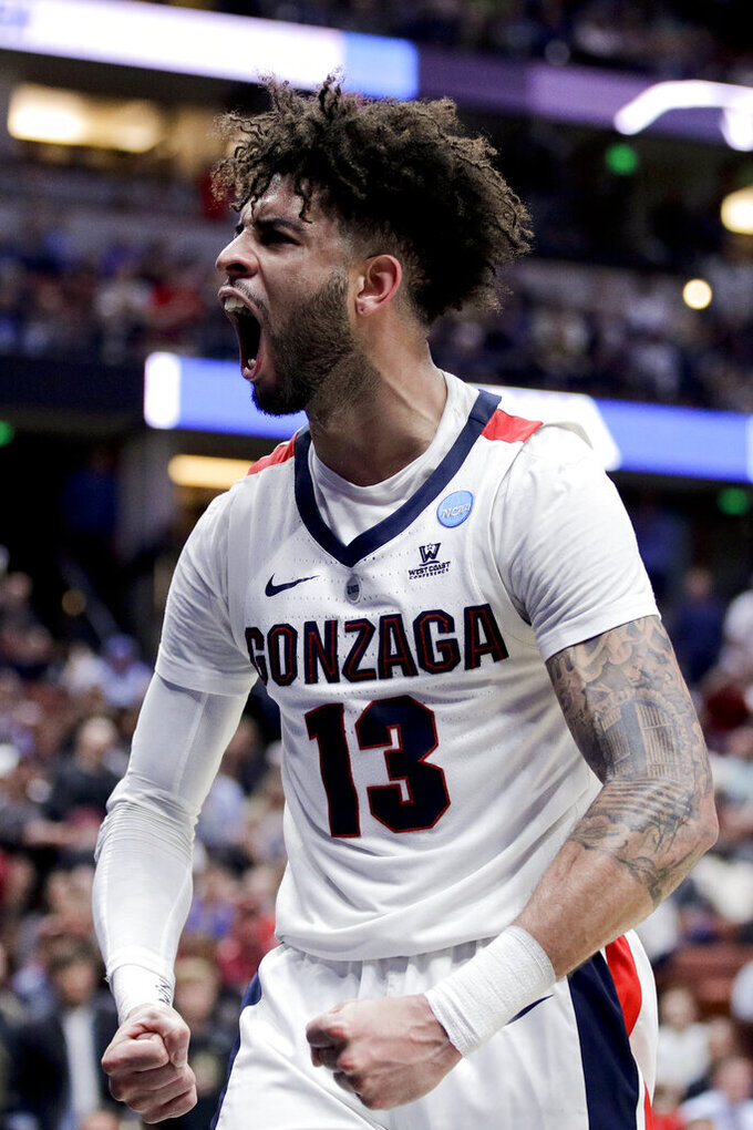 Gonzaga guard Josh Perkins celebrates after scoring against Florida State during the first half an NCAA men's college basketball tournament West Region semifinal Thursday, March 28, 2019, in Anaheim, Calif. (AP Photo/Jae C. Hong)