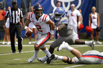 Mississippi quarterback Matt Corral (2) scrambles ahead of Memphis defensive lineman John Tate IV in the first half of an NCAA college football game Saturday, Aug. 31, 2019, in Memphis, Tenn. (AP Photo/Brandon Dill)