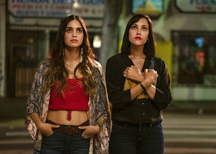 This image released by Starz shows Melissa Barrera, left, and Mishel Prada from the series