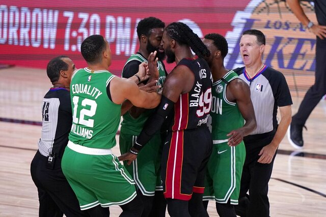Referee Eric Lewis (42), Boston Celtics' Grant Williams (12), referee Pat Fraher (26), right, and Kemba Walker, second from right, attempt to separate Jaylen Brown, center left, and Miami Heat's Jae Crowder (99) after a verbal exchange between the two during the second half of an NBA conference final playoff basketball game, Saturday, Sept. 19, 2020, in Lake Buena Vista, Fla. (AP Photo/Mark J. Terrill)