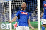 Napoli's Dries Mertens celebrates after scoring the opening goal of his team during the Champions League Group E soccer match between Napoli and Liverpool, at the San Paolo stadium in Naples, Italy, Tuesday, Sept. 17, 2019. (AP Photo/Gregorio Borgia)