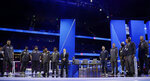Los Angeles Rams and New England Patriots team members line up on stage during Opening Night for the NFL Super Bowl 53 football game Monday, Jan. 28, 2019, in Atlanta. (AP Photo/Matt Rourke)