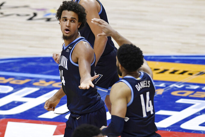 Villanova's Jeremiah Robinson-Earl, left, slaps hands with Caleb Daniels during the second half of the team's NCAA college basketball game against Boston College, Wednesday, Nov. 25, 2020, in Uncasville, Conn. (AP Photo/Jessica Hill)