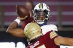 Georgia Tech quarterback Jeff Sims passes under pressure from Boston College defensive end Marcus Valdez (97) during the first half of an NCAA college football game, Saturday, Oct. 24, 2020, in Boston. (AP Photo/Michael Dwyer)