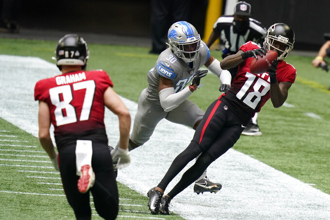 Atlanta Falcons wide receiver Calvin Ridley (18) makes the catch against Detroit Lions cornerback Jeff Okudah (30) during the first half of an NFL football game, Sunday, Oct. 25, 2020, in Atlanta. (AP Photo/Brynn Anderson)