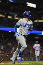 Los Angeles Dodgers' Joc Pederson (31) drops his bat after hitting a two-run home run against the San Francisco Giants during the second inning of a baseball game Friday, Sept. 27, 2019, in San Francisco. (AP Photo/Tony Avelar)