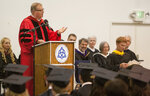 FILE - In this June 8, 2013, file photo, Father Timothy Backous, OSB, delivers the commencement address during the Trinity School commencement ceremony on inside the People of Praise Community Center in South Bend, Ind. (Robert Franklin/South Bend Tribune via AP)