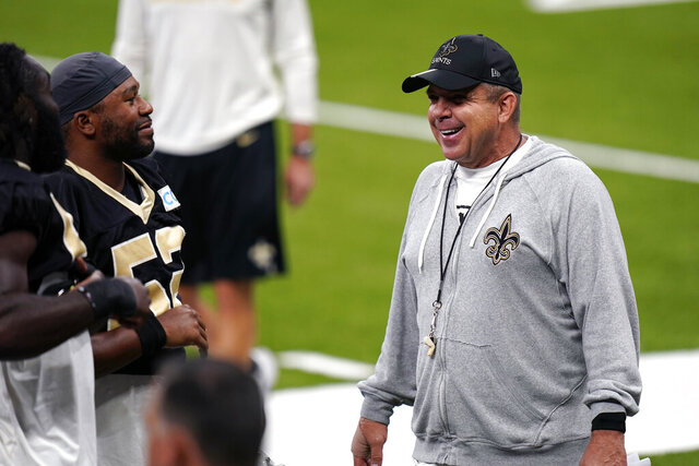 New Orleans Saints head coach Sean Payton laughs with players during NFL football practice in  New Orleans, Thursday, Sept. 3, 2020. (AP Photo/Gerald Herbert, Pool)