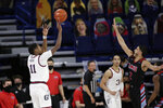 Gonzaga guard Joel Ayayi (11) shoots in front of Loyola Marymount guard Joe Quintana (2) during the first half of an NCAA college basketball game in Spokane, Wash., Saturday, Feb. 27, 2021. (AP Photo/Young Kwak)
