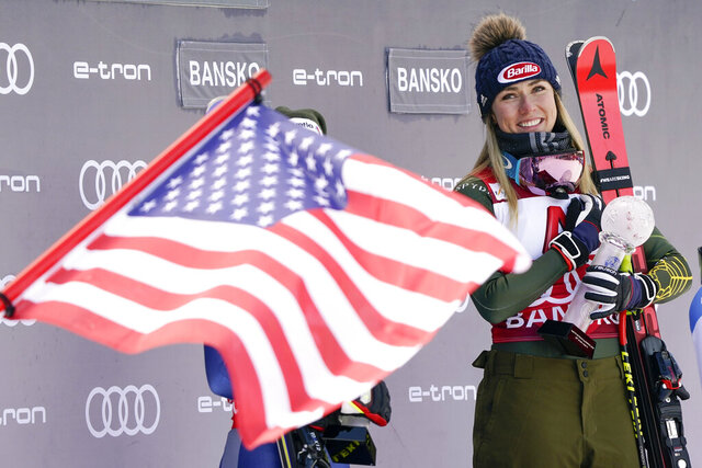 FILE - In this Sunday, Jan. 26, 2020 file photo, United States' Mikaela Shiffrin smiles on the podium after winning the alpine ski, women's World Cup super-G, in Bansko, Bulgaria. A year that turned Mikaela Shiffrin's world upside-down has left the American standout wondering how much time she has left in ski racing. The double Olympic and three-time overall World Cup champion is questioning how long all the traveling will still be worth it.  (AP Photo/Giovanni Auletta, File)