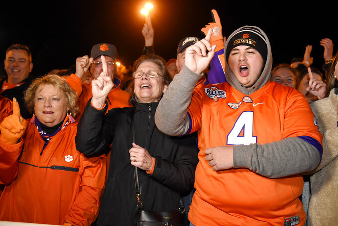 Clemson fans celebrate as the  team returns to campus Tuesday, Jan. 8, 2019, in Clemson, S.C., the day after the Tigers defeated Alabama 44-16 in the College Football Playoff championship game. (AP Photo/Richard Shiro)
