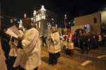 Christian clergymen carry a wooden relic believed to be from Jesus' manger outside the Notre Dame church in Jerusalem, Friday, Nov. 29, 2019. Christians are celebrating the return to the Holy Land of a tiny wooden relic believed to be from Jesus' manger nearly 1,400 years after it was sent to Rome as a gift to the pope. (AP Photo/Mahmoud Illean)
