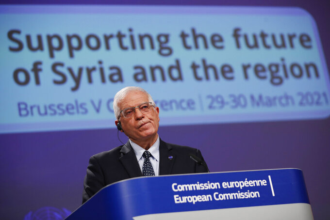European Union foreign policy chief Josep Borrell listens to a question during an online joint news conference with UN Under-Secretary General for Humanitarian Affairs and Emergency Relief Coordinator Mark Lowcock at the conclusion of a conference 'Supporting the future of Syria and the region' at the European Commission headquarters in Brussels, Tuesday, March 30, 2021. (AP Photo/Francisco Seco, Pool)