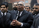 Mohammad Azhar Siddique, center, a lawyer for former Pakistani President and military ruler Pervez Musharraf, talks to journalists after a court decision, in Lahore, Pakistan, Monday, Jan. 13, 2020. The Pakistani court Monday overturned death sentence given to the country's ailing former dictator, saying a special court that last month convicted and sentenced Musharraf had been formed in violation of the law. (AP Photo/K.M. Chaudary)