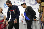 Climate activist Greta Thunberg applauds other activists before giving a news conference at the COP25 climate summit in Madrid, Spain, Monday, Dec. 9, 2019. Thunberg is in Madrid where a global U.N.-sponsored climate change conference is taking place. (AP Photo/Andrea Comas)