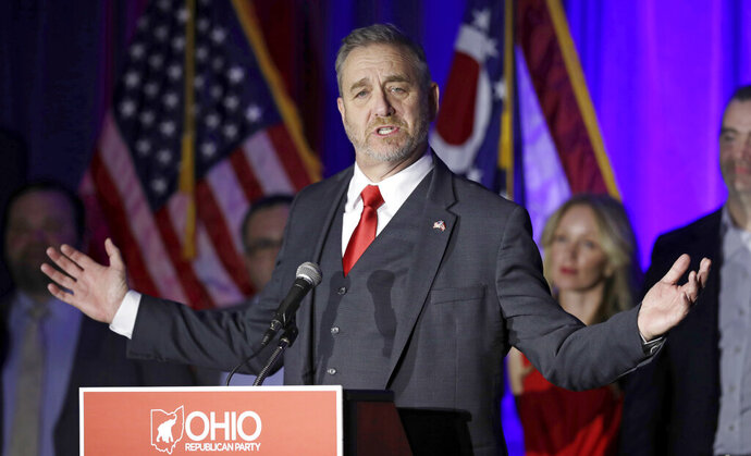FILE - In a Nov. 6, 2018 file photo, Dave Yost speaks at the Ohio Republican Party event, in Columbus, Ohio.  Two Ohio counties are telling a court to deny their state Attorney General Dave Yost's request to delay a major trial over the toll of opioids. Yost Yost asked a federal appeals court in August 2019 not to let a district judge move ahead with a case scheduled to begin Oct. 21. (AP Photo/Tony Dejak, File)