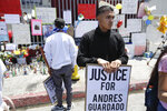 A protester holds a sign during a march in honor of Andres Guardado, Sunday, June 21, 2020, in Gardena, Calif. Guardado was shot Thursday after Los Angeles County sheriff's deputies spotted him with a gun in front of a business near Gardena. (AP Photo/Marcio Jose Sanchez)