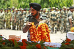 An Indian Border Security Force (BSF) soldier pays tribute to four of their colleagues who were killed early Wednesday during a wreath-laying ceremony at the BSF headquarters in Jammu, India, Wednesday, June 13, 2018. Indian and Pakistani forces fired along the highly militarized frontier in disputed Kashmir early Wednesday after Pakistani firing killed at least four Indian paramilitary soldiers and injured three others on border patrol, Indian officials said. (AP Photo/Channi Anand)