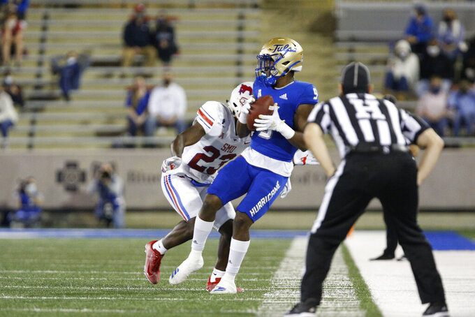 Tulsa wide receiver Sam Crawford Jr. catches a pass against SMU defensive back Brandon Stephens during the first half of an NCAA college football game in Tulsa, Okla., Saturday, Nov. 14, 2020. (AP Photo/Joey Johnson)