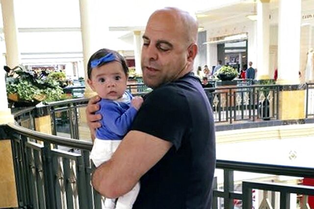 In this June 2016, photo provided by Guila Fakhoury, her father Amer Fakhoury holds his granddaughter, Kira, in King of Prussia, Penn. At a Senate Foreign Relations Committee hearing on Wednesday, Dec. 4, 2019, U.S. Sen. Jeanne Shaheen of New Hampshire said Fakhoury, an American citizen jailed in his native Lebanon since September 2019 on no charges is very ill and if he dies there, then Lebanon should be subject to sanctions. The 57-year-old restaurant owner was once part of the South Lebanon Army and worked at a former prison described by human rights groups as a center for torture. His family says he's innocent.(Guila Fakhoury via AP)