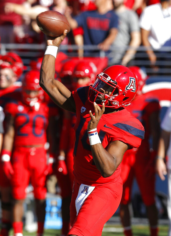 Arizona quarterback Khalil Tate throws downfield against Arizona State in the first half during an NCAA college football game, Saturday, Nov. 24, 2018, in Tucson, Ariz. (AP Photo/Rick Scuteri)