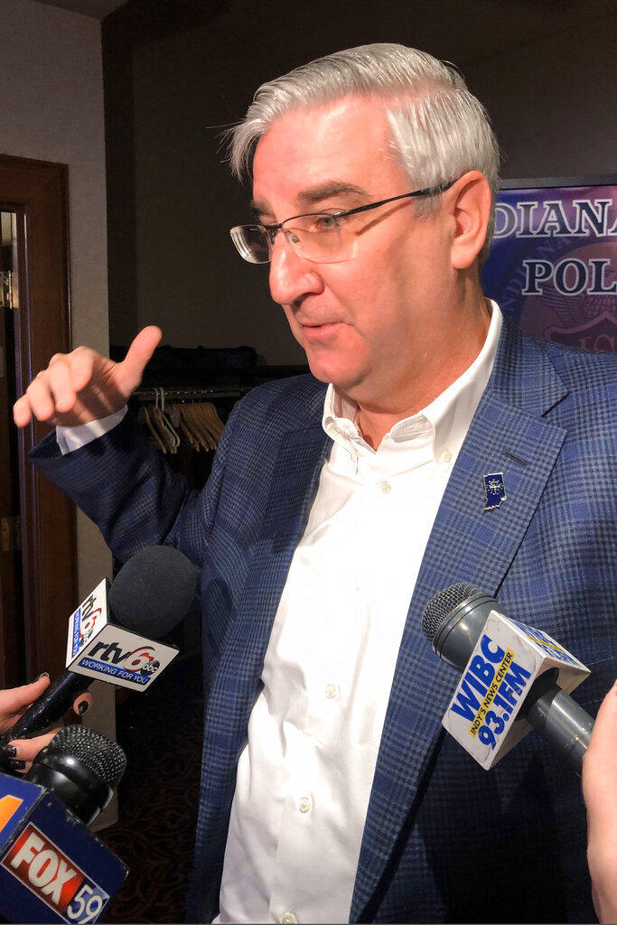 Indiana Gov. Eric Holcomb speaks with reporters Thursday, Nov. 13, 2019, at the Old National Center in Indianapolis. Holcomb didn't criticize more than 100 school districts for closing the day of a union-organized rally at the Statehouse next week, saying it was a local decision. (AP Photo/Tom Davies)(AP Photo/Tom Davies)