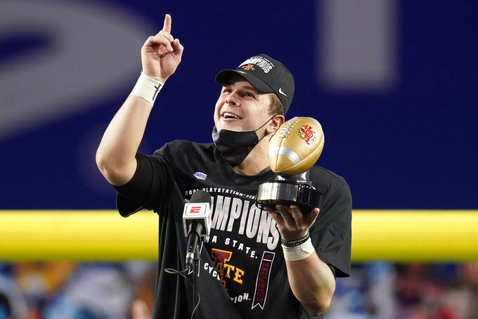 Iowa State quarterback Brock Purdy holds the offensive player of the game award after the Fiesta Bowl NCAA college football game against Oregon, Saturday, Jan. 2, 2021, in Glendale, Ariz. Iowa State won 34-17.(AP Photo/Ross D. Franklin)