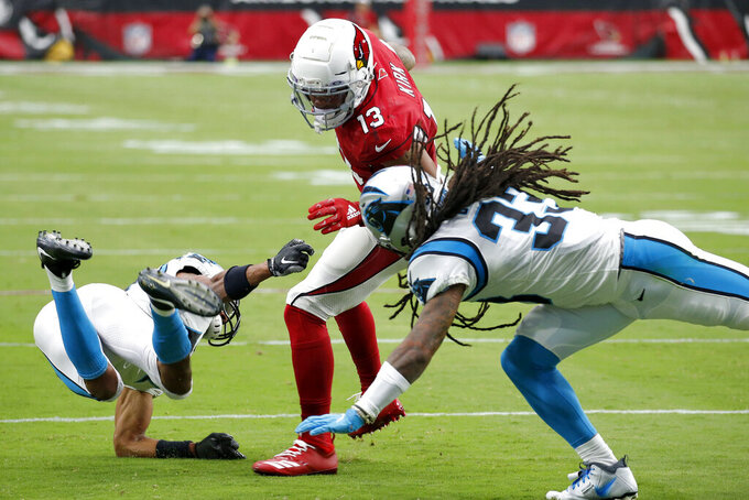 Arizona Cardinals wide receiver Christian Kirk (13) is hit by Carolina Panthers defensive back Tre Boston (33) during the first half of an NFL football game, Sunday, Sept. 22, 2019, in Glendale, Ariz. (AP Photo/Ross D. Franklin)