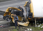 Emergency personnel work at the scene of a school bus and dump truck collision, injuring multiple people, on Interstate 80 in Mount Olive, N.J., Thursday, May 17, 2018. (AP Photo/Seth Wenig)