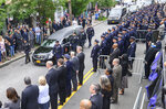 Retired New York police Detective Luis Alvarez's funeral procession makes its way through a sea of police officers Wednesday July 3, 2019, in the Queens borough of New York. Alvarez died Saturday, June 29, 2019 after a three-year battle with colorectal cancer. He attributed his illness to the three months he spent digging through rubble at the World Trade Center's twin towers after the 2001 terrorist attacks. (J. Conrad Williams Jr./Newsday via AP)