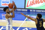 Kentucky's B.J. Boston, left, shoots while defended by Notre Dame's Prentiss Hubb during the second half of an NCAA college basketball game in Lexington, Ky., Saturday, Dec. 12, 2020. Notre Dame won 64-63. (AP Photo/James Crisp)