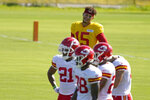 Kansas City Chiefs quarterback Patrick Mahomes (15) watches practice at NFL football training camp Tuesday, Aug. 17, 2021, in St. Joseph, Mo. (AP Photo/Charlie Riedel)