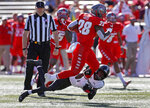 Hawaii defensive back Cortez Davis (18) tackles New Mexico running back Ahmari Davis (28) during the first half of an NCAA college football game on Saturday, Oct. 26, 2019, in Albuquerque, N.M. (AP Photo/Andres Leighton)